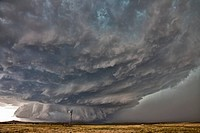 Tornadic supercell thunderstorm over a plain. Supercell thunderstorms are severe long_lived storms within which the wind speed and direction changes w...