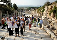 Tourists in Ephesus, Efes, UNESCO World Heritage Site, view from the Curetes Street to the Library of Celsus at back, Selcuk, Lycia, Southwest Turkey,...