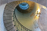 Angle shot of a lighthouse´s spiral stair lighted by electric lamp, vortex