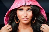 Close up of woman in hood and earrings