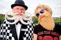 Willi Chevalier a competitor at the 2010 USA National Beard and Moustache Championships with a young woman in a fake beard, in Bend, OR, USA  June 5, ...
