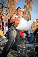 A young man takes part in International Pillow Fight Day--a flash-mob wherein participants bring a pillow and fight--in New York City, NY, USA