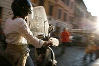 person riding scooter moped in rome italy