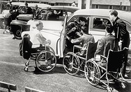 In a rehabilitation centre a group of Americans disabled in wheelchairs waiting to try out some readjusted cars United States, July 1945