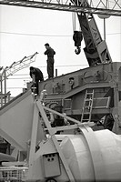 Italian workers working with a crane at Fiera Campionaria in Milan.Milan, 1965