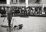 The photographer Sergio Del Grande is preparing to take a groupphoto of the 104 members of the family of Pope John XXIII, bornAngelo Giuseppe Roncalli...