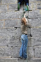 family picture of teenage boy and girl climbing a wall together