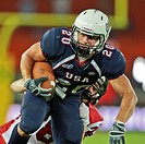 Taylor Malm, 20 USA, is tackled at the Football World Championship on July 16, 2011, USA wins 50:7 against Canada and wins the tournament, Vienna, Aus...
