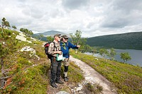 Two hikers on a hiking trail, near Sylen on Lake Grøvelsjøn, Groevelsjoen, Femundsmarka Nasjonalpark, National Park, Hedmark province, Norway, Scandin...