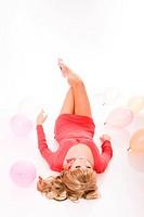 Beautiful fashion model in mini dress lying down on floor