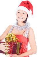 Beautiful christmas woman in santa hat holding gift