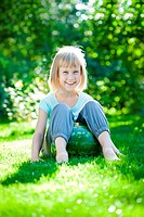 Child sitting on watermelon
