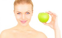 Attractive girl holding a green apple isolated on a white background