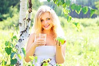 Beautiful girl holding a glass of water