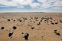 Rusted cans in the sand between Al Fayoum Oasis and Bahariya Oasis, Western Desert, Egypt, Africa