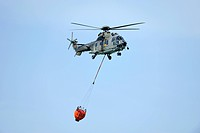 Super Puma helicopter with a helicopter bucket, Switzerland, Europe