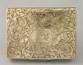 Silversmith's Art, Great Britain 19th century. Silver cigar case with rococo' decoration. Detail: back side with initial letters and scene of oriental...