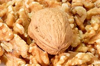 Fresh Walnuts in detail as background