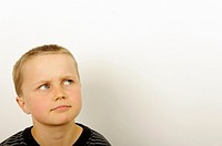 Stock Photo of a young boy thinking