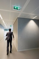 Businessman rushing in office corridor