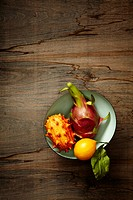 Bowl of exotic fruit on wood