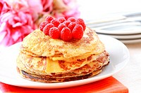 Sweet pancakes with fresh raspberries