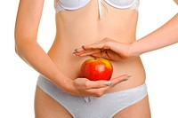 Female shapely a body and a red apple. It is isolated on a white background