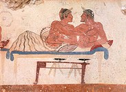 Symposium scene, ca 480-490 BC, decorative fresco from the north wall of the Tomb of the Diver at Paestum, Campania, Italy. Detail of the so-called lo...