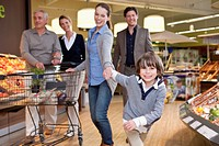 Family with son 6-7 shopping in supermarket (thumbnail)