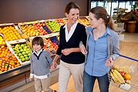 Grandmother, mother and son 6_7 shopping in supermarket