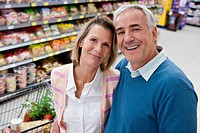 Portrait of middle_aged couple shopping in supermarket