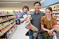 Portrait of family with son 6_7 shopping in supermarket
