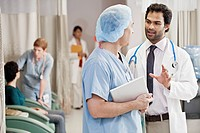 Doctors talking on hallway