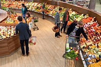 People shopping in vegetable department