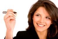 Businesswoman holding a pen to write something _ isolated