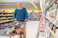 Man doing shopping in supermarket