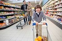 Parents with son 6_7 doing shopping