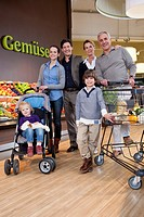 Portrait of three generation family in supermarket