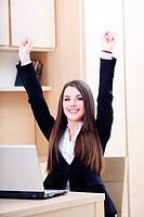 Happy young businesswoman happy because of good news from laptop