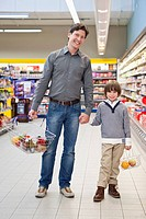 Father and son 6_7 shopping in supermarket