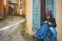 Mural of a woman in a wall of Orgosolo, Sardinia, Italy
