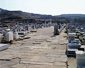 Procession route which connects the southern square with the sanctuary in Delos, (UNESCO World Heritage Site, 1990), Cyclades Islands, Greece. Greek c...