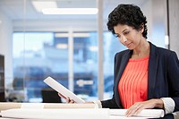 businesswoman reviewing papers