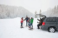 Friends preparing to snowshoe