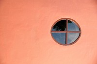 Round window with a flat wall.