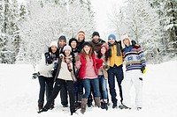 Group photo of young people in snowy countryside