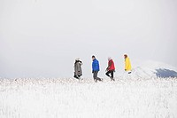 Friends hiking in the wintery countryside (thumbnail)