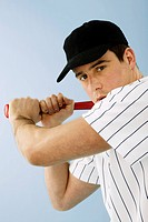 Portrait of baseball player holding bat