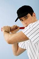 Portrait of baseball player holding bat