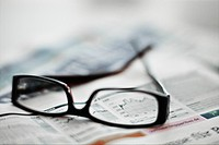 Eye glasses on financial newspaper